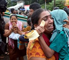 Rush to bring aid to 2 million homeless as fears grow over spread of disease after floods in Kerala