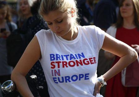 A woman wearing a vote remain tee-shirt reacts, following the result of the EU referendum, in London, Britain June 24, 2016. REUTERS/Neil Hall