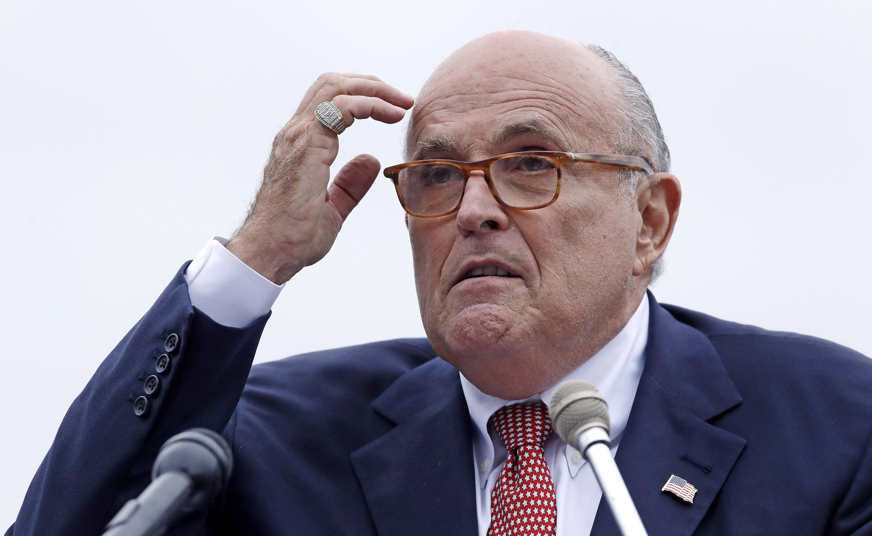 """FILE - In this Aug. 1, 2018 file photo, Rudy Giuliani, an attorney for President Donald Trump, addresses a gathering during a campaign event for Eddie Edwards, who is running for the U.S. Congress, in Portsmouth, N.H. Lawyers speaking publicly on behalf of President Donald Trump and his longtime """"fixer""""-turned-foe Michael Cohen have been fumbling the facts of late. Giuliani recently caused a stir regarding the possibility of Trump granting a pardon to former campaign chairman Paul Manafort and Giuliani also has misspoken about the Trump Tower meeting. (AP Photo/Charles Krupa, File )"""