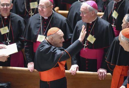 Cardinal Archbishop Emeritus Theodore McCarrick waves to fellow bishops as he attends the midday prayer service at the Cathedral of St. Matthews in Washington September 23, 2015. REUTERS/Jonathan Newton/Pool