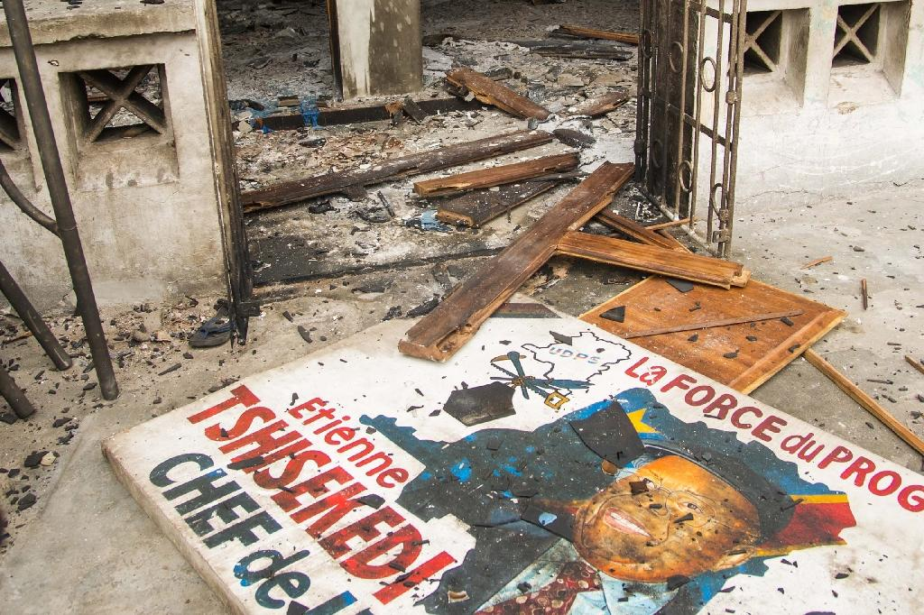 The entrance of offices of the main opposition Union for Democracy and Social Progress party which were torched overnight and early on September 20, 2016 (AFP Photo/Junior D. Kannah)