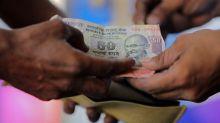Rupee hits record low of 74.28 per dollar