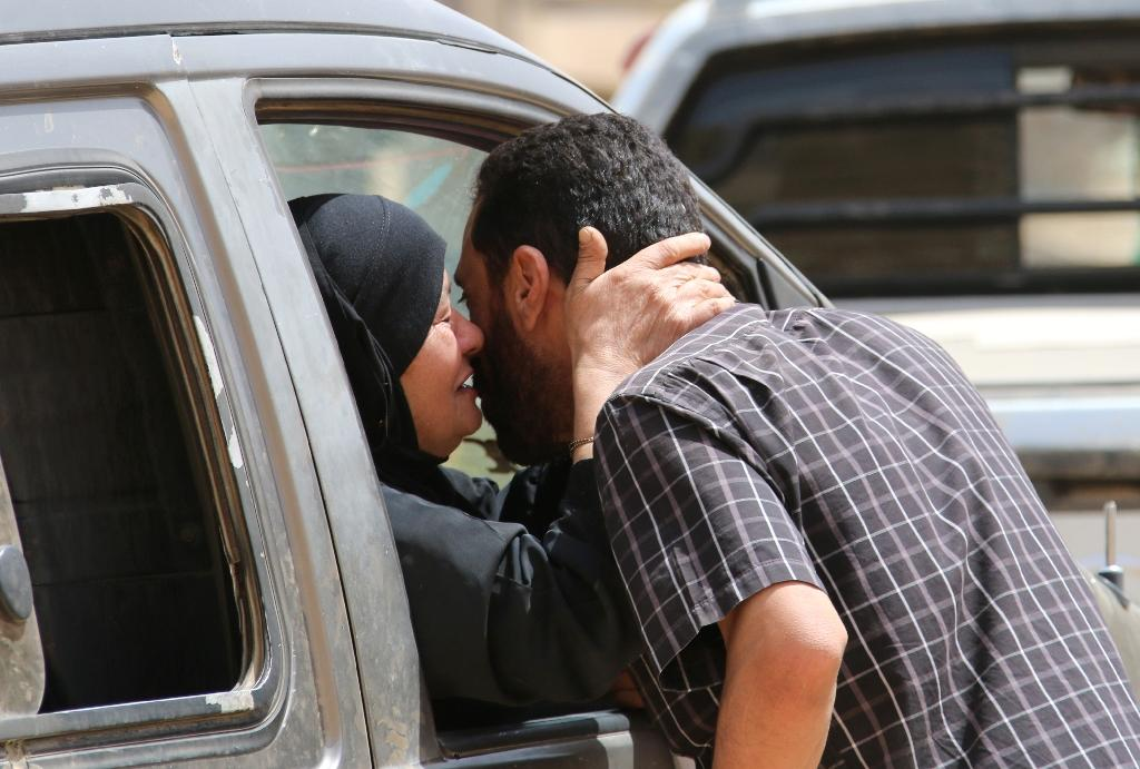 (FILES) A Syrian refugee kisses a relative as she sits inside a vehicle in the eastern Lebanese border town of Arsal (AFP Photo/STRINGER)