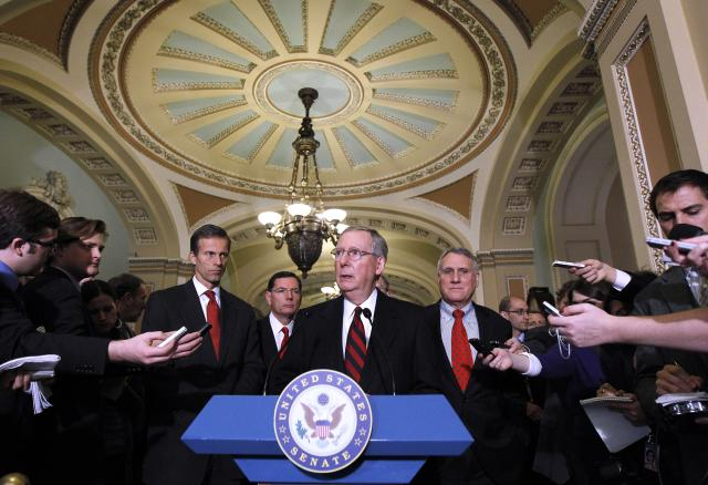 Senate Minority Leader Mitch McConnell, center, meets reporters on Capitol Hill in Washington, Tuesday, Dec. 7, 2010. From left are Sen. John Thune, R-S.D., Sen. John Barrasso, R-Wyo., McConnell, and Sen. Jon Kyl, R-Ariz. (Photo: Alex Brandon/AP)