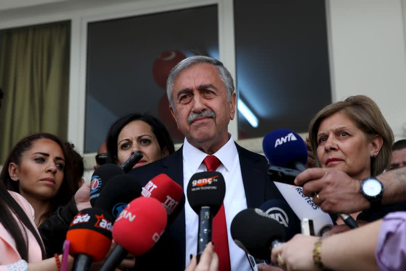 FILE PHOTO: Turkish Cypriot leadership candidate Mustafa Akinci speaks to media after voting at an elementary school in northern Nicosia