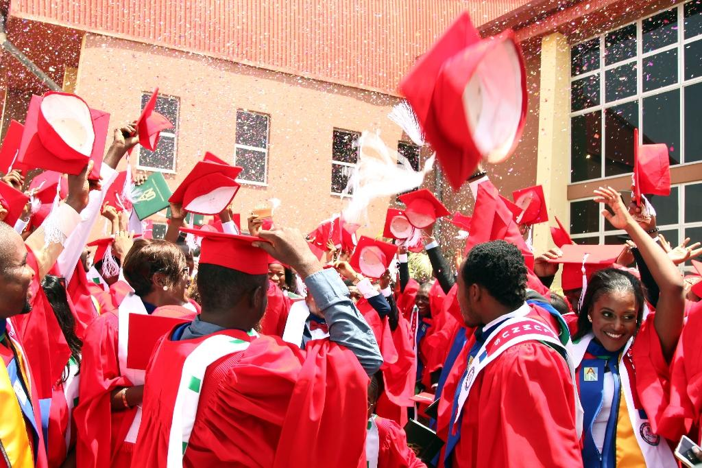 Graduating students of the American University of Nigeria in Yola celebrate after their commencement ceremony at the school on May 9, 2015