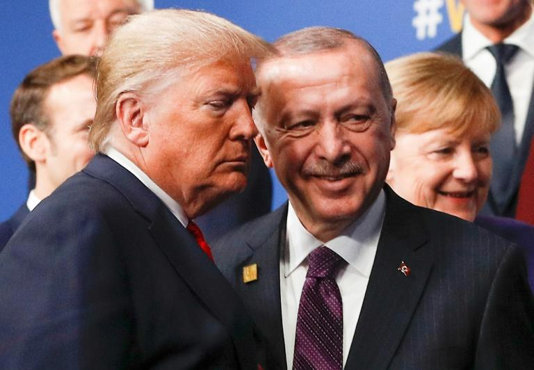 US President Donald Trump and Turkey's President Recep Tayyip Erdogan leave the stage after a family photo at the NATO summit in England in December 2019 (AFP Photo/PETER NICHOLLS)