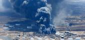 Dark smoke rises from Husky Energy oil refinery following an explosion in Superior, Wis. (Reuters)
