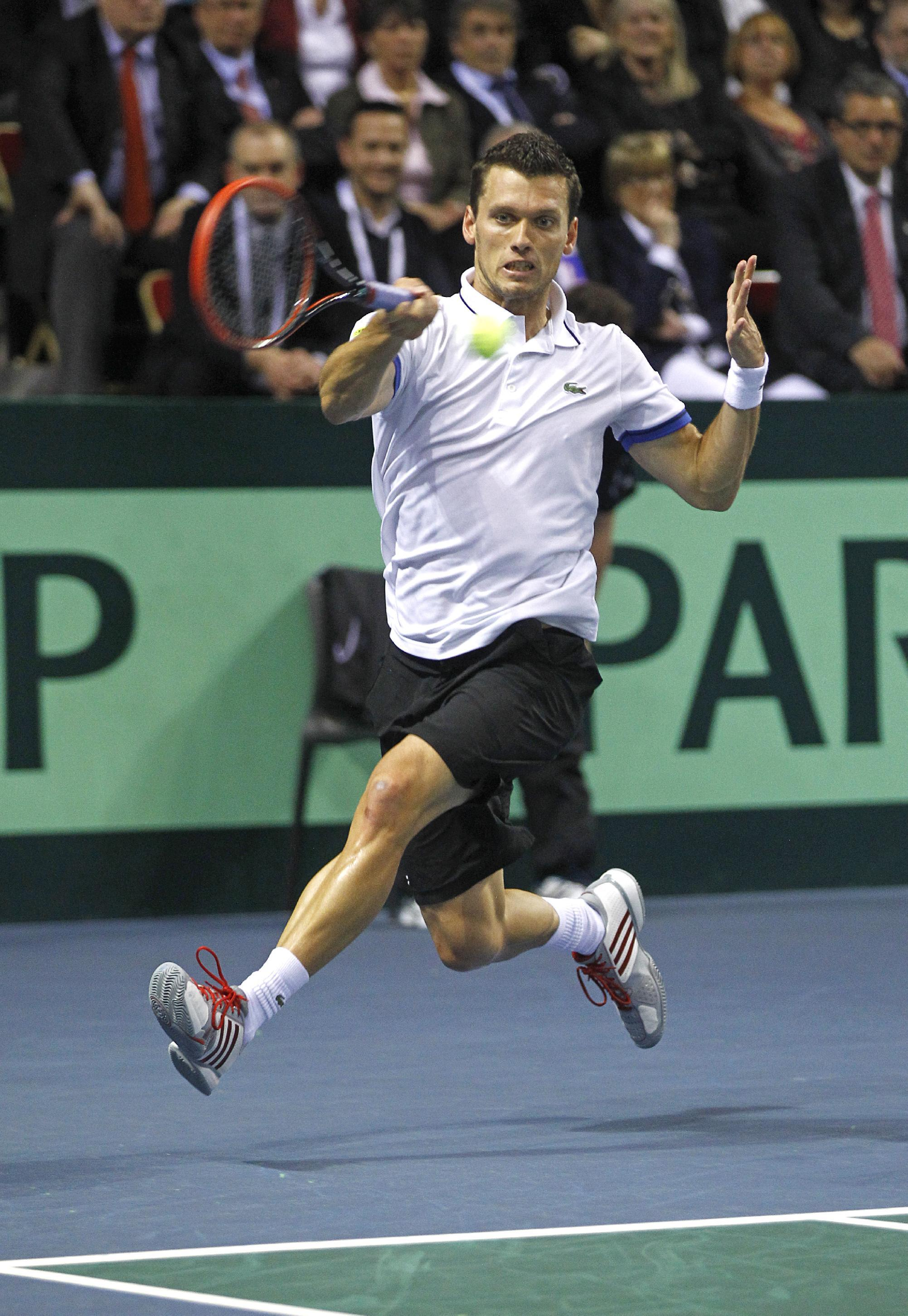 German player Tobias Kamke returns the ball to French player Jo-Wilfried Tsonga during their singles match in the quarterfinals of the Davis Cup between France and Germany, in Nancy, eastern France, Sunday April 6, 2014.(AP Photo/Remy de la Mauviniere)
