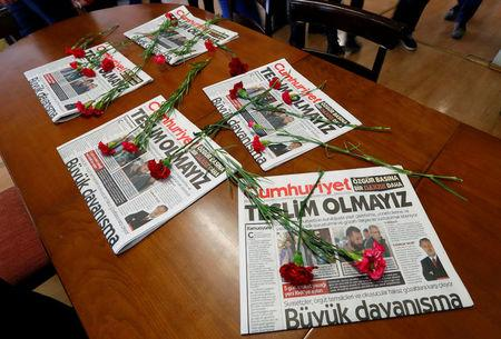 Carnations and today's copies are seen in the newsroom of Cumhuriyet newspaper, an opposition secularist daily, in Istanbul,