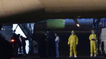 US evacuates from Japan virus ship as China death toll climbs