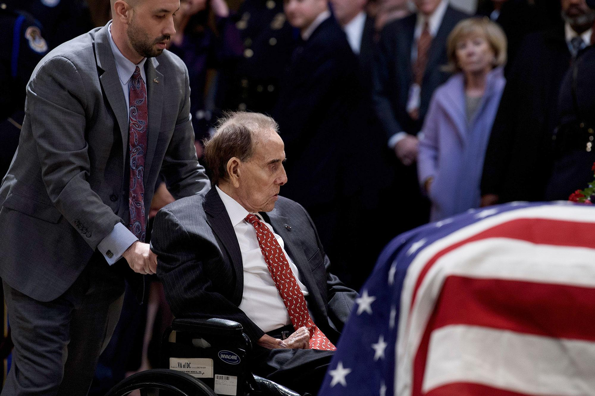 Former Sen  Bob Dole, 95, Helped Out of Wheelchair to Salute Casket