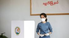Myanmar's Suu Kyi casts early vote in poll hit by COVID-19 curbs