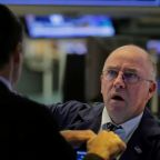 Wall Street sinks as weak forecasts add to dour mood; Nasdaq nears correction