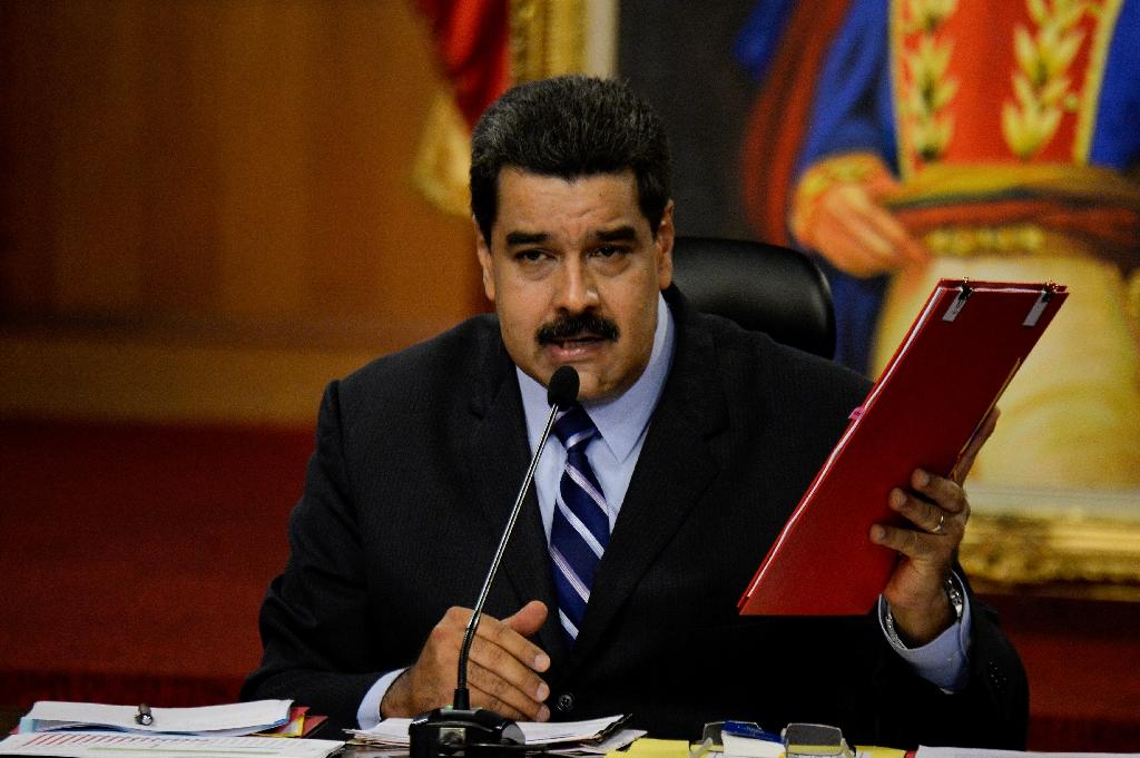 Venezuelan President Nicolas Maduro regularly accuses business elites of waging an 'economic war' against him by hoarding supplies to aggravate the crisis (AFP Photo/Federico Parra)