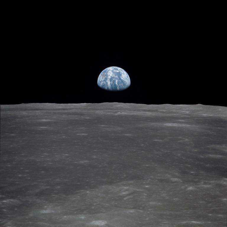 This photo obtained from NASA and taken by the Apollo 11 crew shows an Earthrise viewed from lunar orbit prior to landing on July 20, 1969 (AFP Photo/HO)