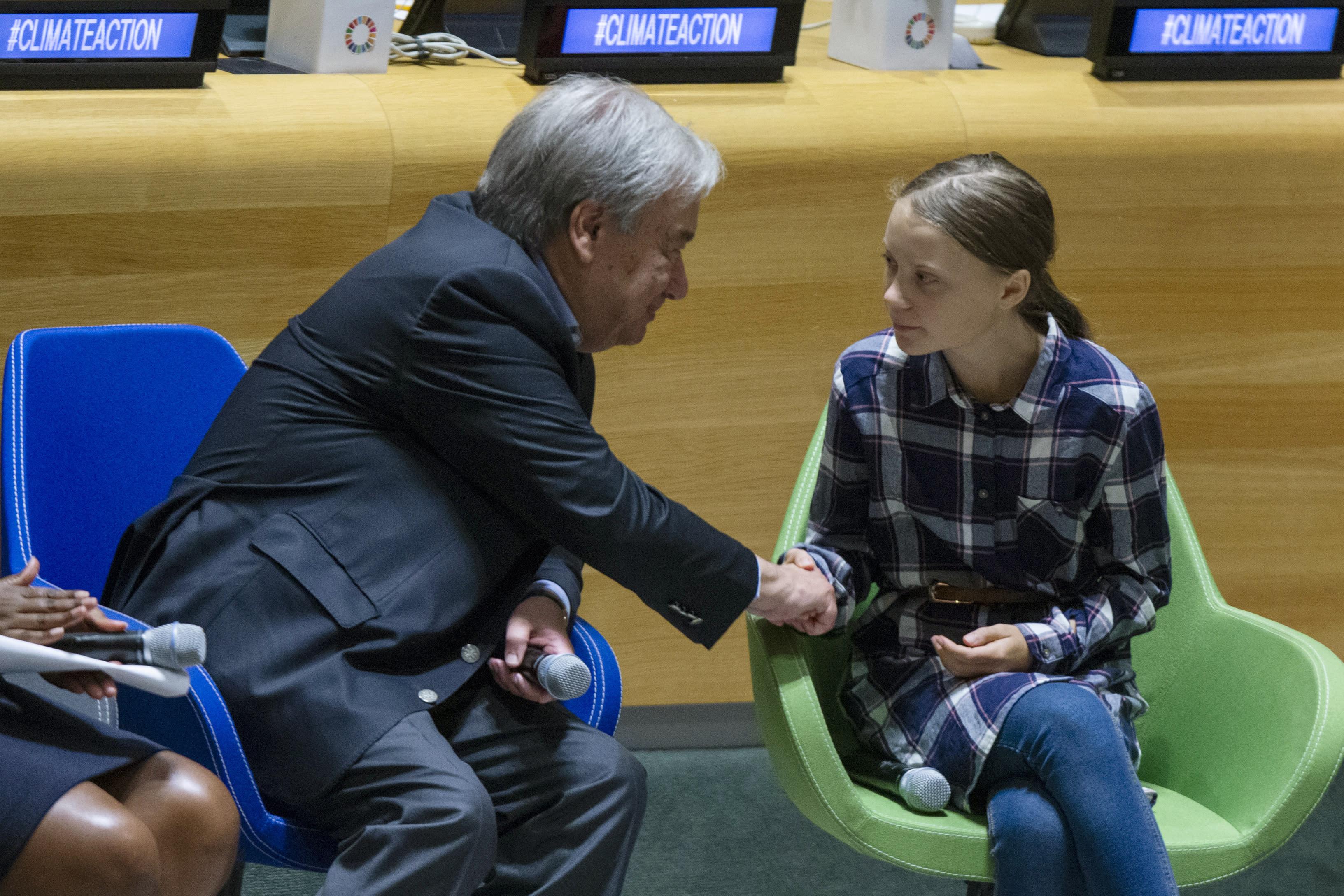 Swedish environmental activist Greta Thunberg, right, shakes hands with U.N. Secretary-General Antonio Guterres, during the Youth Climate Summit at United Nations headquarters, Saturday, Sept. 21, 2019. (AP Photo/Eduardo Munoz Alvarez)