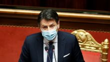 Italy PM wins backing for deficit hike after surviving coalition ambush