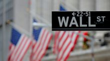Wall Street rises modestly on Walmart bump