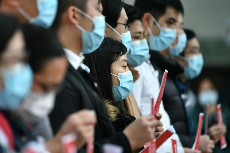 Local medical workers in Hong Kong hold a strike near Queen Mary Hospital as they demand the city close its border with China to reduce the coronavirus spreading (AFP Photo/Anthony WALLACE)