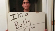 'I'm a bully. Honk if you hate bullies': Dad makes son hold sign as punishment