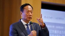Top Foxconn executives visit White House, but mum on details