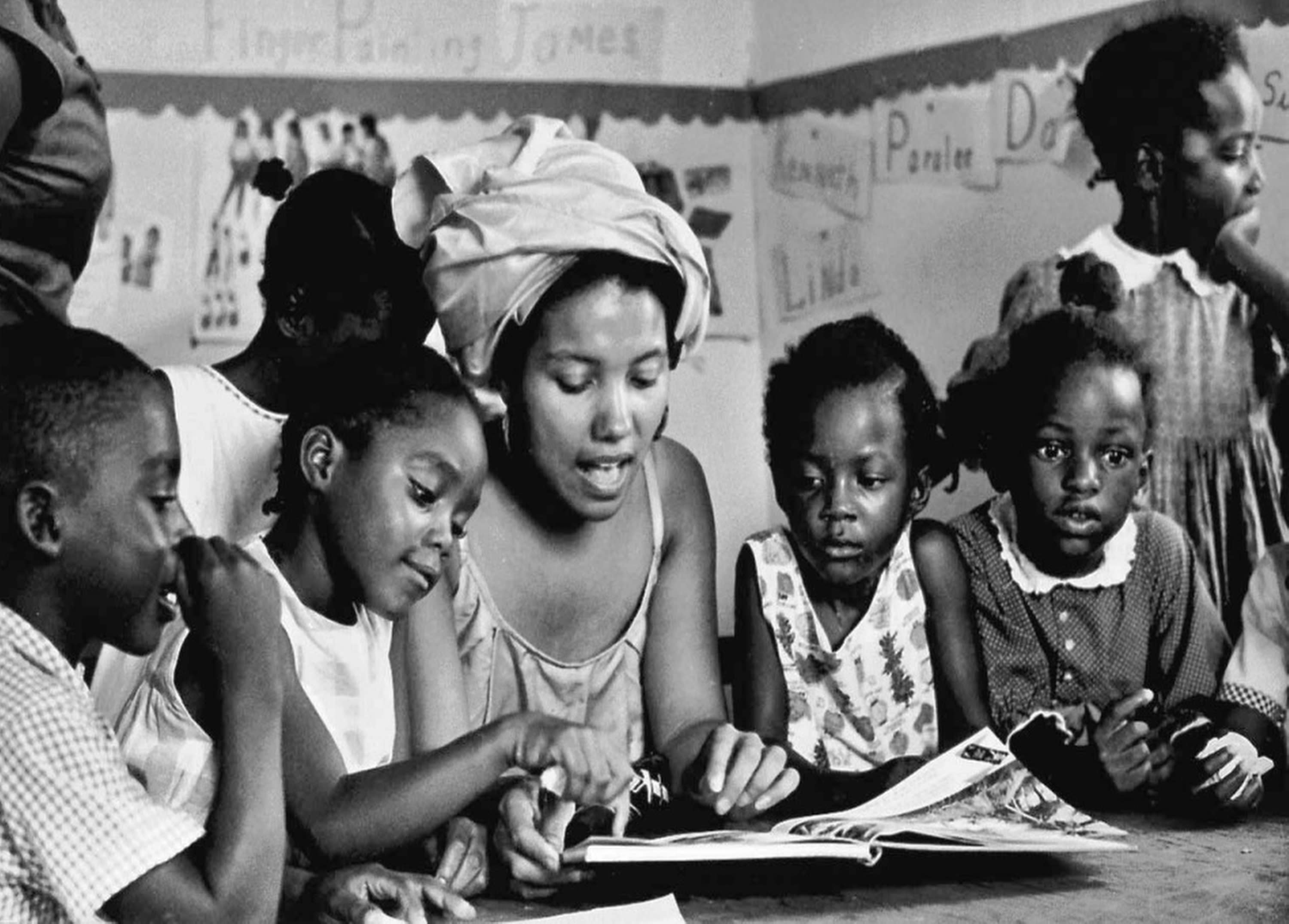 This 1966 photo provided by Maria Varela shows a member of the Student Nonviolent Coordinating Committee, SNCC, working with students in a Head Start program in Canton, Miss. The photo was taken by Varela, then a member of SNCC, and was one of the few Latinos involved in the black civil rights movement. (AP Photo/Maria Varela, File)