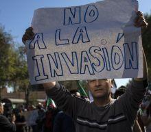Protesters Opposing Migrant Caravan Clash With Police In Tijuana