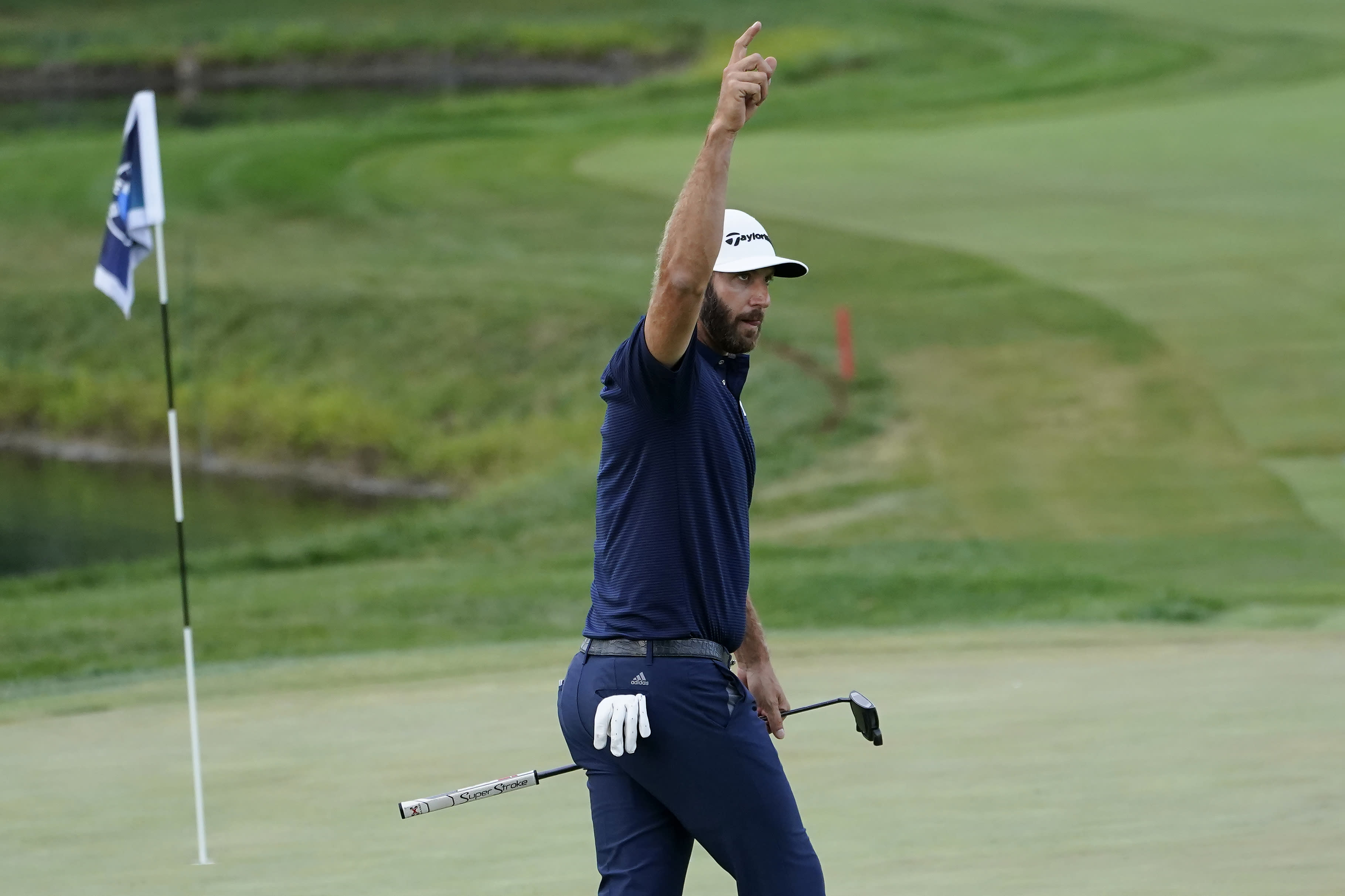 Dustin Johnson reacts after making a birdie putt on the 18th hole during the final round of the BMW Championship golf tournament at the Olympia Fields Country Club in Olympia Fields, Ill., Sunday, Aug. 30, 2020. (AP Photo/Charles Rex Arbogast)