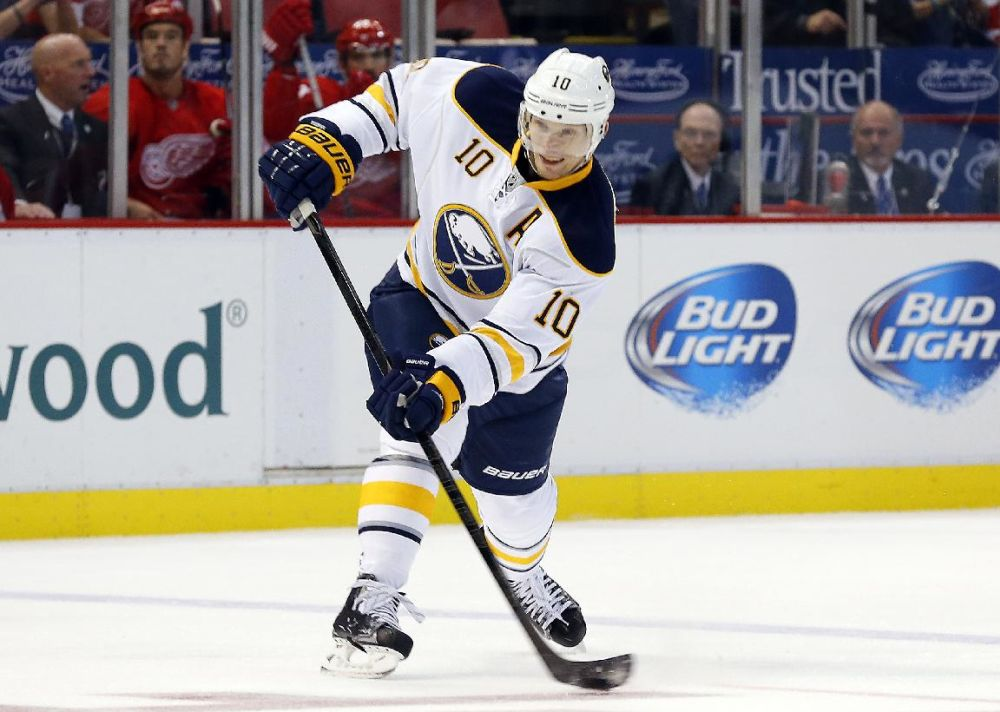 In this Oct. 2, 2013 file photo, Buffalo Sabres defenseman Christian Ehrhoff, of Gemany, shoots against the Detroit Red Wings in the first period of an NHL hockey game in Detroit.  A person familiar with the move says veteran defenseman Christian Ehrhoff has agreed to sign with the Pittsburgh Penguins. The person spoke to The Associated Press on the condition of anonymity because the Penguins had not announced the deal, reached a half hour into the start of the NHL's free agency period on Tuesday, Juloy 1, 2014