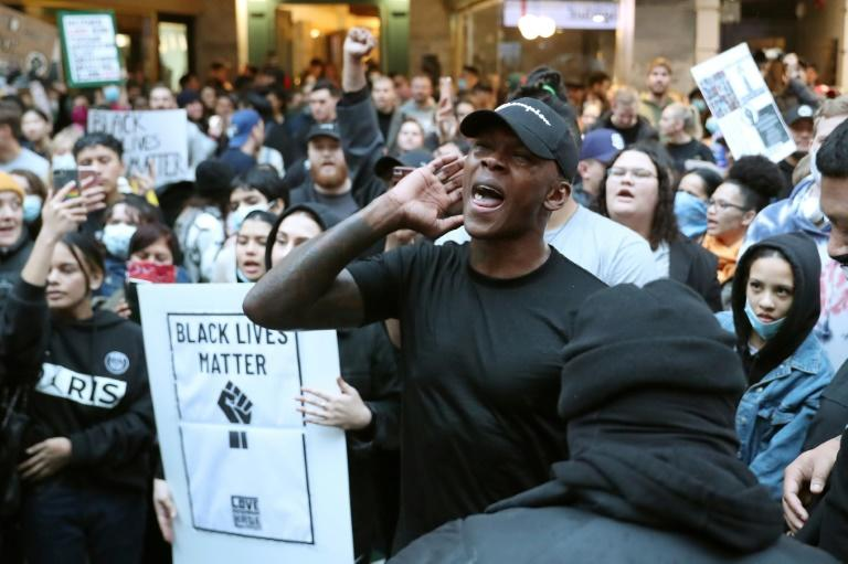 UFC figther Israel Adesanya was among thousands of New Zealanders who took to the streets (AFP Photo/MICHAEL BRADLEY)