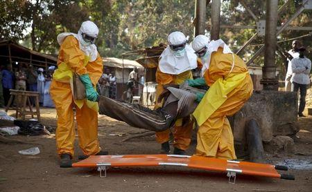 A French Red Cross team picks up a suspected Ebola case from the centre of Forecariah
