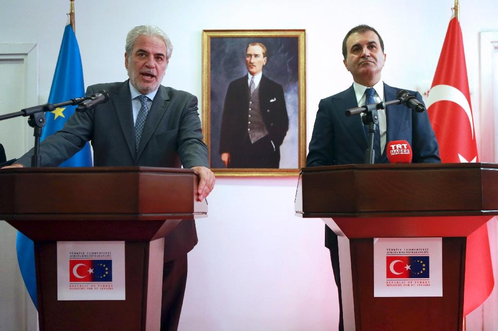 European Commissioner for Humanitarian Aid and Crisis Management Christos Stylianides (L) delivers a speech next to Turkey's EU Minister Omer Celik (R) during a joint press conference following their meeting on September 26, 2016 (AFP Photo/Adem Altan)