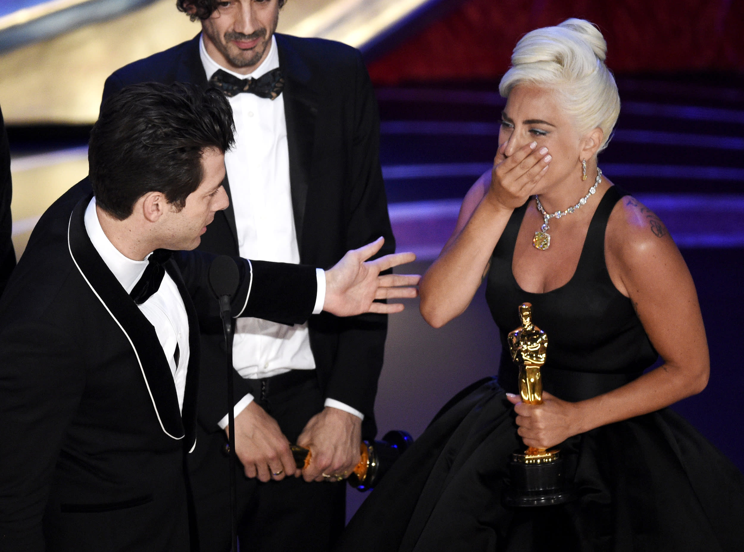 """Mark Ronson, from left, Anthony Rossomando and Lady Gaga accept the award for best original song for """"Shallow"""" from """"A Star Is Born"""" at the Oscars on Sunday, Feb. 24, 2019, at the Dolby Theatre in Los Angeles. (Photo by Chris Pizzello/Invision/AP)"""