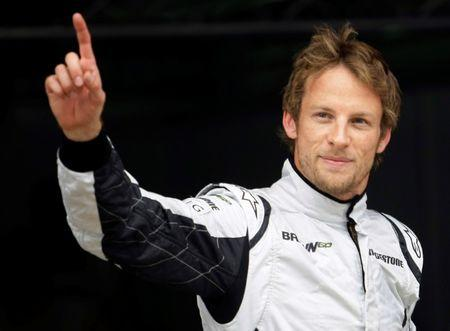Brawn GP driver Jenson Button waves after qualifying in pole position for the Spanish F1 Grand Prix at the Catalunya racetrack in Montmelo