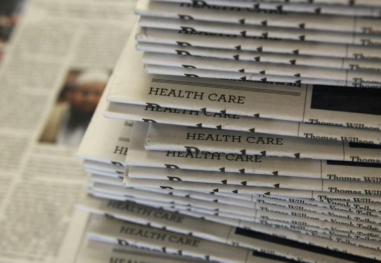 The COVID-19 pandemic has already forced cutbacks and layoffs at newspapers in the US while ad revenues fall sharply (AFP Photo/JUSTIN SULLIVAN)