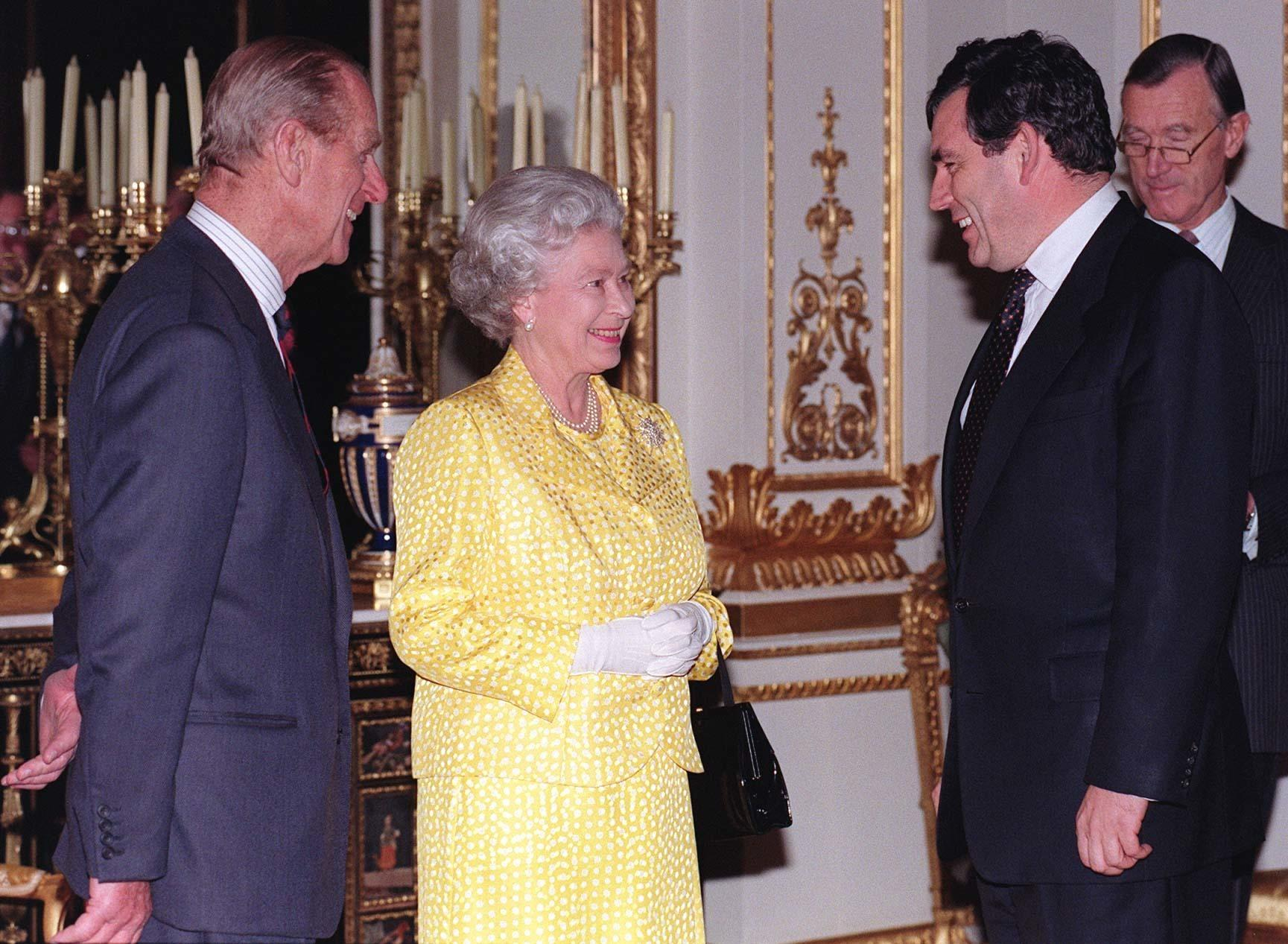 The Queen and the Duke of Edinburgh talk to Chancellor Gordon Brown (right), tonight (Weds), as 350 representatives from various City organisations gathered at a reception at Buckingham Palace. See PA Story ROYAL City. Photo by Fiona Hanson. WPA Rota.