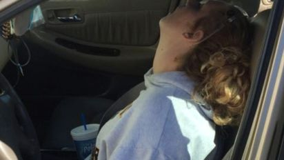 Mum overdosed with child in the back seat: police