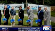 Florida city councilman photobombs groundbreaking in another city, holding imaginary shovel