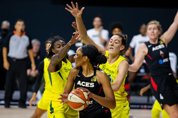 Oct 6, 2020; Bradenton, Florida, USA; Las Vegas Aces center A'ja Wilson (22) looks to pass as Seattle Storm forward Natasha Howard (6) and forward Breanna Stewart (30) defend during game three of the 2020 WNBA Finals at IMG Academy. Mandatory Credit: Mary Holt-USA TODAY Sports