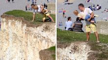 Heart-stopping moment man holds toddler over crumbling cliff