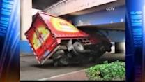 Truck wedged under overpass in China