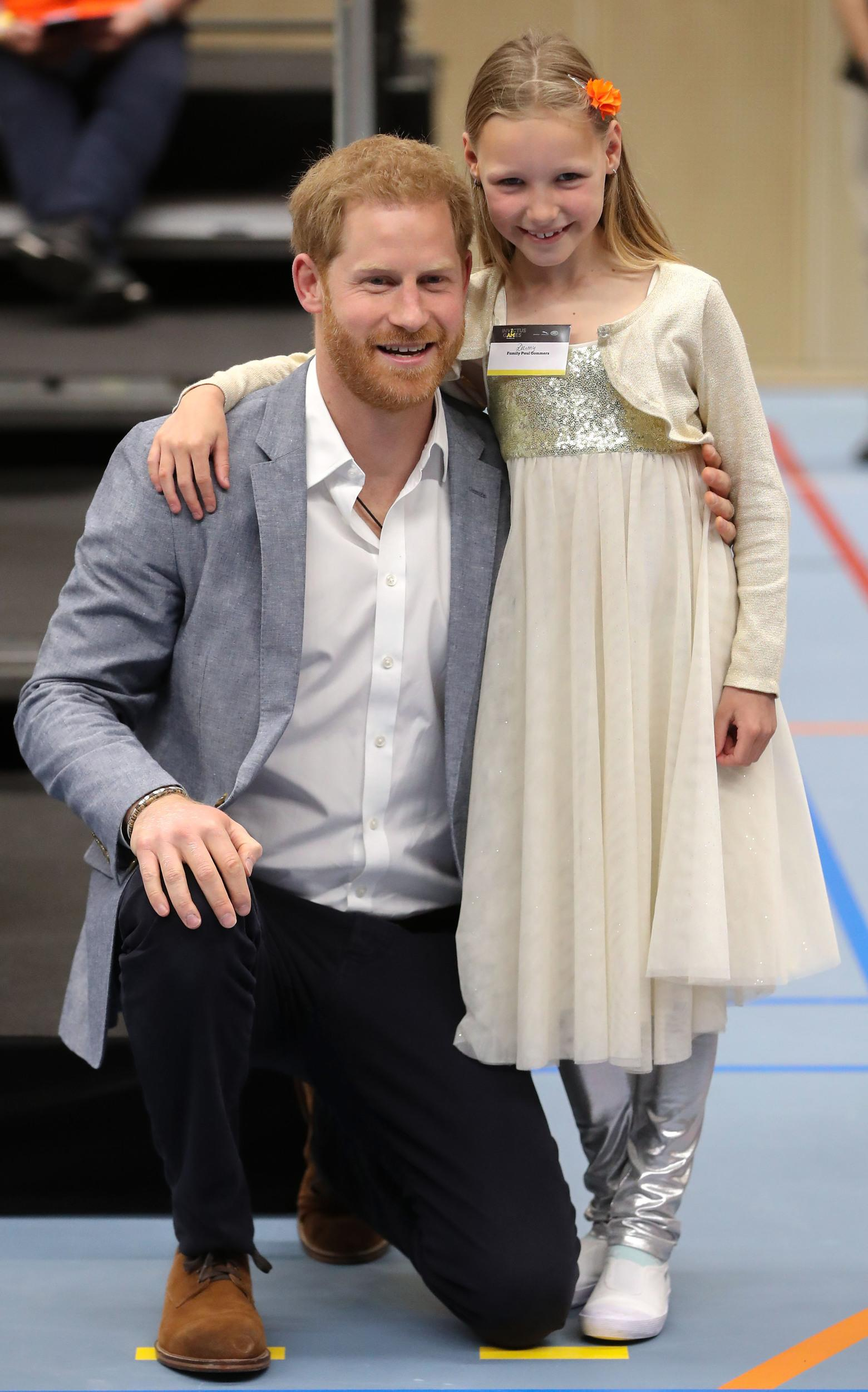 THE HAGUE, NETHERLANDS - MAY 09: Prince Harry, Duke of Sussex poses with a competitors family member at a sports training session at Sportcampus Zuiderpark during a visit to The Hague as part of a programme of events to mark the official launch of the Invictus Games. HRH will spend time meeting potential competitors and their families, joining the Netherlands in celebrating what an exciting event The Hague 2020 will be. Prince Harry, Duke of Sussex founded the games in 2014 in which wounded veterans compete in an array of sporting events on May 09, 2019 in The Hague, Netherlands.  (Photo by Chris Jackson Pool/Getty Images)