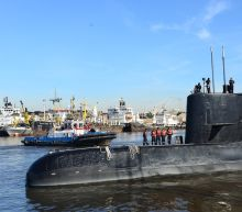 Argentina navy says sub reported problem in final call