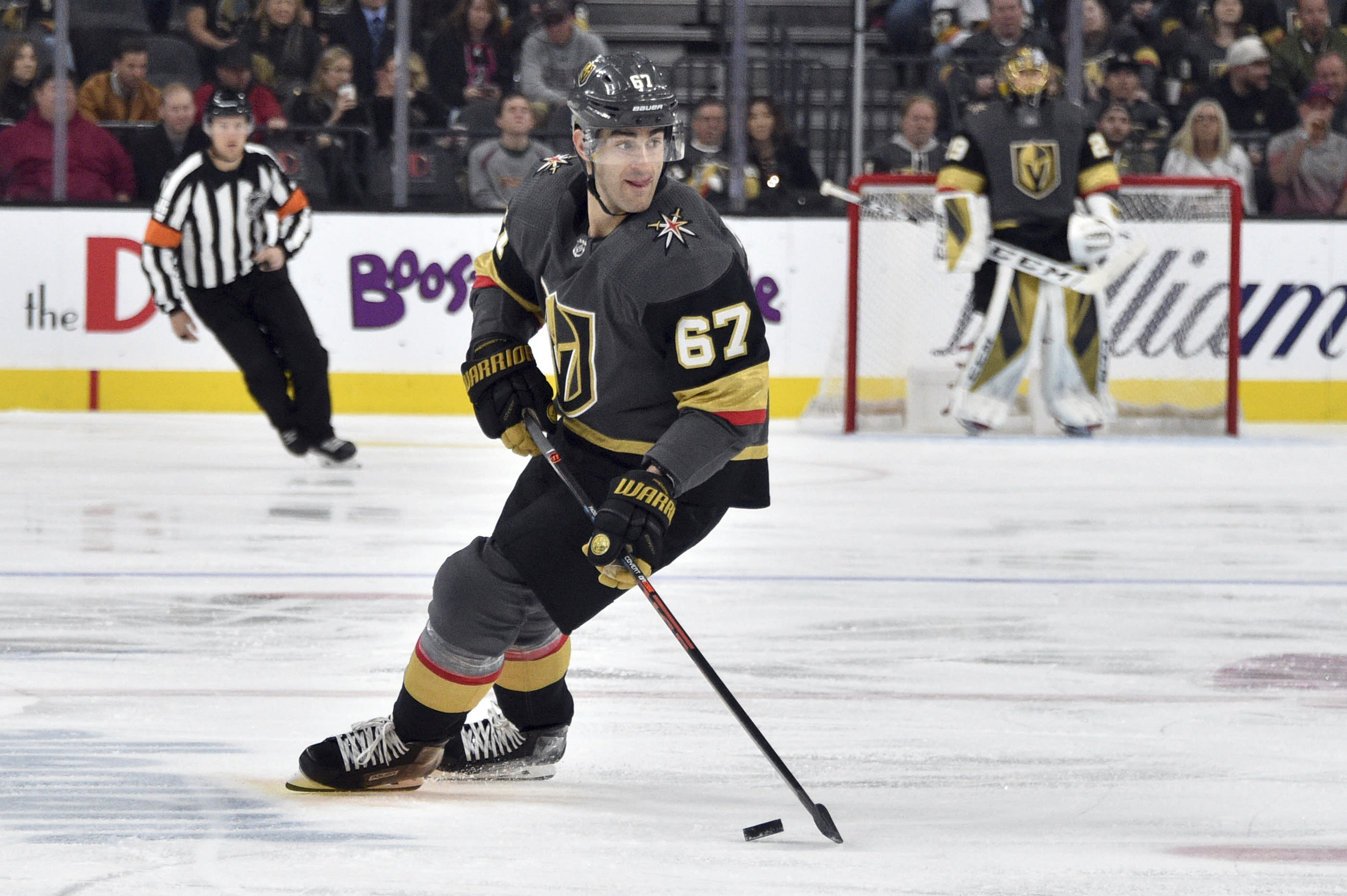 FILE - In this Saturday, Feb. 8, 2020 file photo, Vegas Golden Knights left wing Max Pacioretty (67) skates with the puck against the Carolina Hurricanes during the second period of an NHL hockey game in Las Vegas. The Dallas Stars were in a miserable stretch when the NHL season came to a sudden and unexpected stop 4 1/2 months ago. Vegas was playing some of its best hockey after a coaching change. Both now have the same chance of being the No. 1 seed in the Western Conference playoffs, and a better chance to re-acclimate to playing again than having to jump right into a playoff series for the resumption of this unprecedented season because of the coronavirus.(AP Photo/David Becker, File)