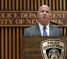 NYPD fires officer 5 years after Garner's chokehold death