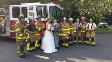 Bride and groom ride to reception with fire department after wedding bus fire