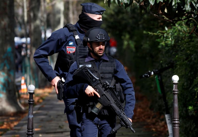 Knifeman in Paris wounds two at scene of Charlie Hebdo attacks