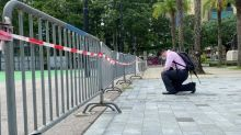 Man kneels at park where HK usually holds Tiananmen vigils