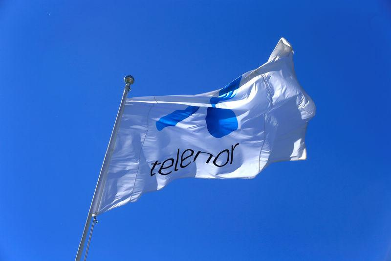 FILE PHOTO: Telenor flag flutters next to the company's headquarters in Fornebu